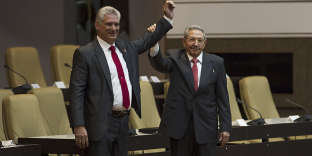 """Handout picture released by Cuban official website www.cubadebate.cu shsowing outgoing Cuban President Raul Castro (R) raising the arm of Cuba's new President Miguel Diaz-Canel after he was formally named by the National Assembly, in Havana on April 19, 2018.   Miguel Diaz-Canel succeeds Raul Castro -- a historic handover ending six decades of rule by the Castro brothers. The 57-year-old Diaz-Canel, who was the only candidate for the presidency, was elected to a five-year term with 603 out of 604 possible votes in the National Assembly.   - RESTRICTED TO EDITORIAL USE - MANDATORY CREDIT """"AFP PHOTO / www.cubadebate.cu"""" - NO MARKETING NO ADVERTISING CAMPAIGNS - DISTRIBUTED AS A SERVICE TO CLIENTS    / AFP / www.cubadebate.cu / HO / RESTRICTED TO EDITORIAL USE - MANDATORY CREDIT """"AFP PHOTO / www.cubadebate.cu"""" - NO MARKETING NO ADVERTISING CAMPAIGNS - DISTRIBUTED AS A SERVICE TO CLIENTS"""