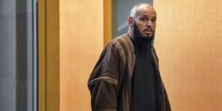 (FILES) In this file photo taken on February 8, 2018 El Hadi Doudi, Algerian imam of a Salafist mosque in Marseille, closed for six months by the Bouches-du-Rhone prefecture for radical sermons, arrives at the Palais de Justice courthouse in Marseille, southern France, where he has been summoned for an eviction commission. El Hadi Doudi, a Salafist imam from Marseille known for his radical preachings, has been expelled to Algeria on early April 20, 2018, according to the French Interior Ministry. / AFP / ANNE-CHRISTINE POUJOULAT