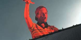 (FILES) In this file photo taken on August 14, 2015 Swedish DJ, remixer, record producer and singer Tim Bergling, better known by his stage name 'Avicii'  performs at the Sziget music festival on the Hajogyar Island of Budapest on August 14, 2015. This cultural event takes place on an island in the middle of the Danube river, in the heart of Budapest. AFP PHOTO / ATTILA KISBENEDEK It was confirmed Avicii died on April 20, 2018 in Muscat, Oman. / AFP / Attila KISBENEDEK