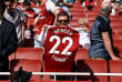 """Soccer Football - Premier League - Arsenal v West Ham United - Emirates Stadium, London, Britain - April 22, 2018   Arsenal fan with a shirt paying tribute to manager Arsene Wenger     Action Images via Reuters/Tony O'Brien    EDITORIAL USE ONLY. No use with unauthorized audio, video, data, fixture lists, club/league logos or """"live"""" services. Online in-match use limited to 75 images, no video emulation. No use in betting, games or single club/league/player publications.  Please contact your account representative for further details."""