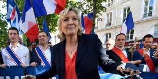 President of the French far-right Front National (FN) party Marine Le Pen attends a rally against the French government's immigration policies next to the National Assembly in Paris on April 20, 2018. / AFP / GERARD JULIEN