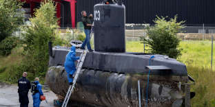 FILE - This is a Sunday, Aug. 13, 2017, file photo of police technicians board Peter Madsen's submarine UC3 Nautilus on a pier in Copenhagen harbour, Denmark. One of the most talked-about and macabre court cases in recent Danish history is set to conclude Wednesday, April 25, 2018 when the verdict is handed down on whether Peter Madsen tortured and murdered a Swedish journalist during a private submarine trip. (Jacob Ehrbahn/Ritzau Scanpix, File via AP)