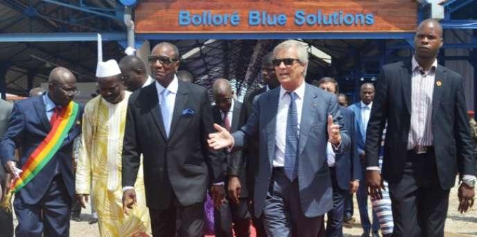 Le président guinéen, Alpha Condé, et l'homme d'affaires Vincent Bolloré, à Conakry, le 12juin 2014.