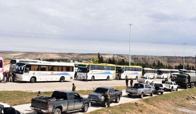 Image diffusée par l'agence de presse officielle du régime syrien de l'évacuation des rebelles à Rastan, le 7 mai .