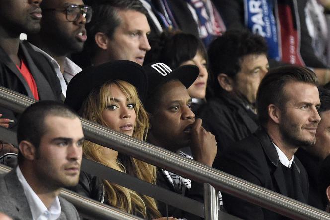 Jay-Z, Beyonce et David Beckham lors d'un match du PSG face à Barcelone, le 30 septembre 2014.