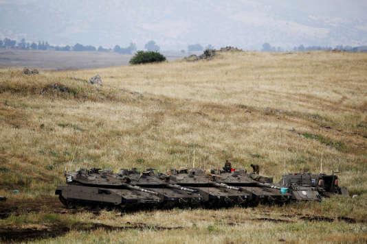 Des chars israéliens près de la la frontière avec la Syrie, sur le plateau du Golan occupé par Israël, le 9 mai.