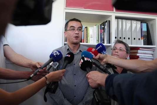 Mohamed Aachour and Nicole Radius, avocats de la famille de Naomi Musenga, répondent aux questions des journalistes, à Strasbourg, le 9 mai.