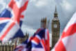 National flags flutter near the The Elizabeth Tower, commonly referred to as Big Ben, in central London on June 9, 2017. British Prime Minister Theresa May said Friday she planned to stick to the timetable for starting Brexit negotiations in 10 days, with a new government that would lead Britain out of the EU. / AFP PHOTO / Glyn KIRK