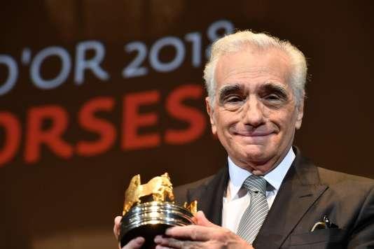 Martin Scorsese recevant le Carrosse d'or attribué par la Société des réalisateurs de films, à Cannes, le 9 mai.