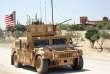 Un véhicule arborant un drapeau américain, à Manbij (Syrie), le 12 mai.