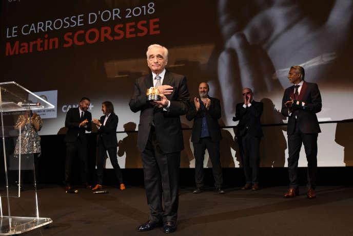 Le réalisateur américain Martin Scorsese reçoit le « Carrosse d'or », une récompense honorant un cinéaste qui a marqué l'histoire du septième art, lors de la 71e édition du Festival de Cannes, le 9 mai.