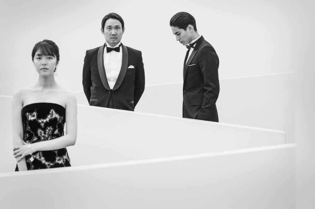 De gauche à droite : l'actrice Erika Karata, le réalisateur Ryusuke Hamaguchi et l'acteur Masahiro Higashide au Palais des festivals, à Cannes, le 14 mai 2018 - Stephan VANFLETEREN pour Le Monde