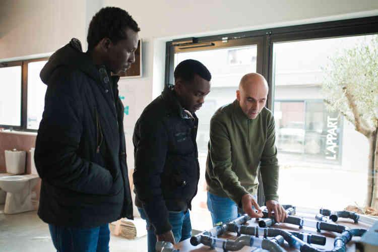 Alsadi, Alrashid et Pierre-Martin Aubelle au centre de formation.