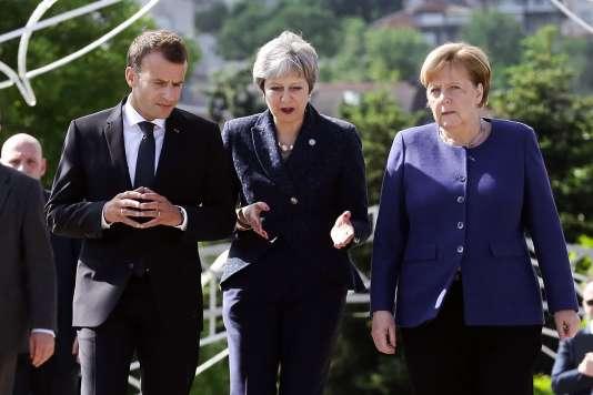 Emmanuel Macron, la première ministre britannique Theresa May et la chancelière allemande Angela Merkel, à Sofia, le 17 mai.