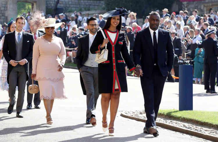 Idris Elba et Sabrina Dhowre, suivis d'Oprah Winfrey, arrivent à la chapelle Saint-Georges.