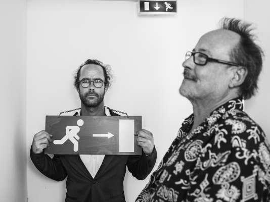 Cédric Herrou et Michel Toesca sur l'une des terrasses du Palais des festivals à Cannes, le 18 mai 2018.