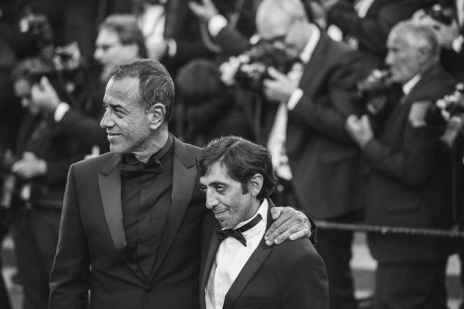Le réalisateur italien Matteo Garrone et l'acteur italien Marcello Fonte lors de lamontée des marches pour la cérémonie de clôture au 71e Festival de Cannes, le 19 mai 2018.