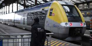 (FILES) In this file photo taken on April 3, 2018 a security staff stands near a train inside Gare de Lyon railway station Paris at the start of three months of rolling rail strikes. Workers of the SNCF, France's heavily indebted state rail operator, will go on strike on May 23, 2018 and May 24, 2018 as part of rolling train strikes set to last until June 28. / AFP / Christophe SIMON