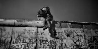 GERMANY. Berlin. On the wall, people celebrating New Year's Eve. Near the Brandenburg Gate, after the fall of the wall in November of 1989. Sunday 31th December, 1989 (around midnight).