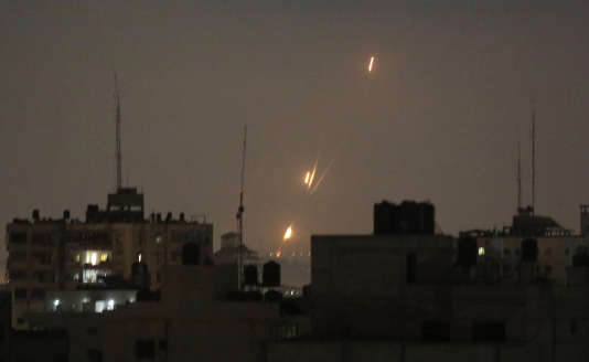 Flames of rockets fired by Palestinian militants are seen over Gaza Strip toward Israeli lands, early Wednesday, May 30, 2018. Palestinian militants bombarded southern Israel with dozens of rockets and mortar shells Tuesday, while Israeli warplanes struck targets throughout the Gaza Strip in the largest flare-up of violence between the sides since a 2014 war. (AP Photo/Hatem Moussa)