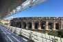 Les arènes de Nîmes, vues du Musée de la romanité.