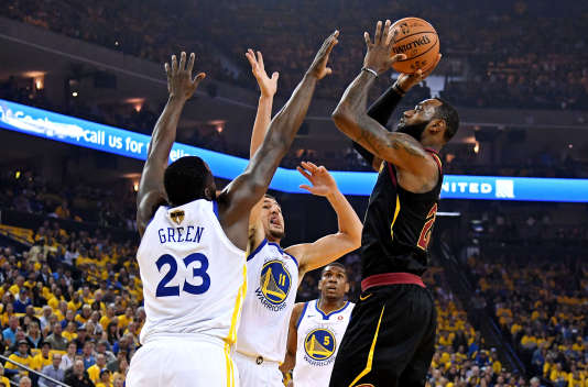 May 31, 2018; Oakland, CA, USA; Cleveland Cavaliers forward LeBron James (23) shoots the ball against Golden State Warriors forward Draymond Green (23) during the first quarter in game one of the 2018 NBA Finals at Oracle Arena. Mandatory Credit: Kyle Terada-USA TODAY Sports