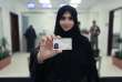 This image released by the Saudi Information Ministry, shows Tahani Aldosemani, Assistant Professor at Prince Sattam Bin Abdulaziz University in Al-Kharj, as she displays her brand new driving license, at the General Department of Traffic in the capital, Riyadh, Monday, June 4, 2018. Saudi Arabia has issued the first driving licenses to 10 women just weeks before the kingdom lifts the world's only ban on women driving, but the surprise move comes as a number of women who'd campaigned for the right to drive are under arrest. (Photos by Saudi Information Ministry via AP)