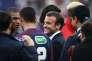 Emmanuel Macron au milieu des joueurs lors de la finale de la coupe de France entre Les Herbiers et le PSG, le 8 mai, au stade de France.