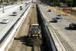 FILE - In this Oct. 15, 2015 file photo, vehicles pass a highway construction site on Interstate 80 in Sacramento, Calif. Proposition 69, the Gas Tax Amendment on the June ballot, will require gas tax money be spent on transportation (AP Photo/Rich Pedroncelli, File)
