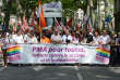"People hold a banner that reads ""PMA (Procreation medicalement assistee - assisted reproductive technology) for all, Lets fight against sexism and lesbophobia"" as they take part in the Lyon Gay Pride, on June 15, 2013 in Lyon. AFP PHOTO/PHILIPPE DESMAZES / AFP PHOTO / PHILIPPE DESMAZES"