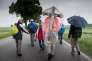 A pilgrim carries a cross covered with a plastic shield to protect it against the rain as he takes part in a pilgrimage on foot on a 111km long tour from Regensburg to Altoetting, in Niedertraubling, southern Germany, on May 17, 2018. - Germany OUT / AFP / dpa / Peter Kneffel