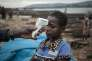 A health worker from the Ministry of Health monitors the temperature of a young traveller from the Democratic Republic of Congo at each port in Bangui on June 3, 2018. Most of the animals reservoir of the Ebola virus, come from Lobaye, a high-risk area on the Congo-Brazzaville border. Having affected the Democratic Republic of Congo, the Ebola virus threatens to spread to the Central African Republic where the Ministry of Health, supported by the WHO, has put in place risk prevention measures.