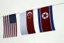 Drapeaux des Etats-Unis, de Singapour et de Corée du Nord quelques jours avant la rencontre entre Donald Trump et Kim Jong-un, à Singapour, le 7 juin.