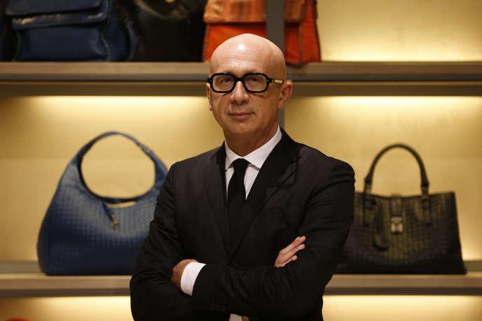 Marco Bizzari, PDG de Gucci, dans un magasin parisien de la marque Bottega Veneta, en mars 2014.
