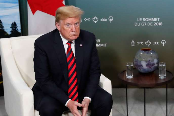 Donald Trump écoutant le premier ministre canadien, Justin Trudeau, lors du sommet du G7, à La Malbaie (Québec), le 8juin.