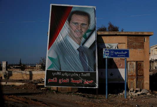 Sur cette affiche, le président syrien Bachar Al-Assad, à al-Ramouseh, près d'Alep, le 8 décembre 2016.