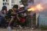 Des manifestants lors de heurts avec la police, le 9 juin près de Managua.