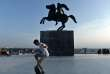 A boy rides on a skateboard in front of the statue of Alexander III of Macedon, commonly known as Alexander the Great, in Thessaloniki on June 12, 2018. Skopje and Athens resolved on June 12, 2018 a longstanding row after Macedonia Prime Minister agreeing to rename his country the Republic of Northern Macedonia, ending a 27-year dispute. / AFP / Sakis MITROLIDIS