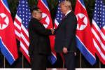 Le président américain Donald Trump et le dirigeant nord-coréen Kim Jong-un, mardi 12 juin 2018.