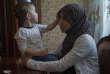 Zagidat Abakarova, 33 ans, pose avec l'un de ses enfants à Makhachkala (Daghestan), en mai. Elle est revenue de Syrie en octobre2017.