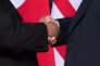 TOPSHOT - US President Donald Trump (R) shakes hands with North Korea's leader Kim Jong Un (L) at the start of their historic US-North Korea summit, at the Capella Hotel on Sentosa island in Singapore on June 12, 2018. Donald Trump and Kim Jong Un became on June 12 the first sitting US and North Korean leaders to meet, shake hands and negotiate to end a decades-old nuclear stand-off. / AFP / SAUL LOEB