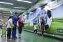 Dans le métro de Pékin, une publicité pour la marque Mengniu, qui a obtenu les droits exclusifs sur la distribution des produits laitiers durant le Mondial.