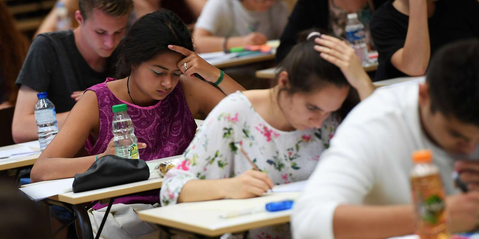 High school students take the philosophy exam, the first test session of the 2017 baccalaureate (high school graduation exam) on June 15, 2017 at the Fustel de Coulanges high school in Strasbourg, eastern France. A total of 520.000 Students of general and technological graduating classes are registered to take their written baccalaureat exams at over 4 400 examination centres across France between June 15-June 22, 2017.