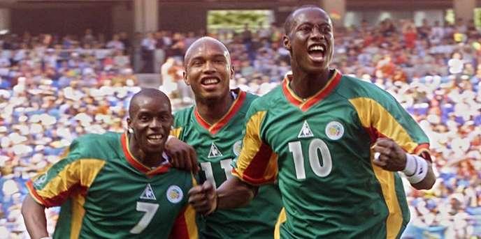 De droite à gauche, Khalilou Fadiga, El Hadji Diouf et Henri Camara, lors de la Coupe du monde 2002.