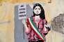 Une fresque représentant la maire de Rome, Virginia Raggi, dans les rues de la ville, le 15 juin.