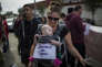 LOS ANGELES, CA - NOVEMBER 12: Sharilyn Fields and her 6-month-old daughter Lily participate in the #MeToo Survivors' March in response to several high-profile sexual harassment scandals on November 12, 2017 in Los Angeles, California. The protest was organized by Tarana Burke, who created the viral hashtag #MeToo after reports of alleged sexual abuse and sexual harassment by the now disgraced former movie mogul, Harvey Weinstein. David McNew/Getty Images/AFP