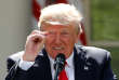 FILE PHOTO: U.S. President Donald Trump refers to amounts of temperature change as he announces his decision that the United States will withdraw from the landmark Paris Climate Agreement, at the White House in Washington, U.S., June 1, 2017. REUTERS/Kevin Lamarque/File Photo