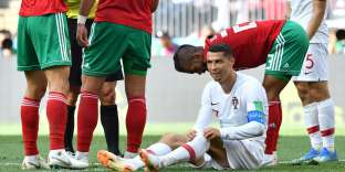 Portugal's forward Cristiano Ronaldo pulls his socks up after falling during the Russia 2018 World Cup Group B football match between Portugal and Morocco at the Luzhniki Stadium in Moscow on June 20, 2018. RESTRICTED TO EDITORIAL USE - NO MOBILE PUSH ALERTS/DOWNLOADS / AFP / FADEL SENNA / RESTRICTED TO EDITORIAL USE - NO MOBILE PUSH ALERTS/DOWNLOADS