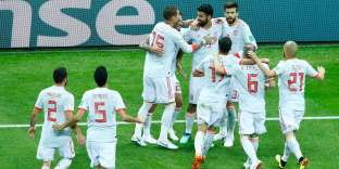 Spain's players celebrate their opening goal during the Russia 2018 World Cup Group B football match between Iran and Spain at the Kazan Arena in Kazan on June 20, 2018. RESTRICTED TO EDITORIAL USE - NO MOBILE PUSH ALERTS/DOWNLOADS / AFP / BENJAMIN CREMEL / RESTRICTED TO EDITORIAL USE - NO MOBILE PUSH ALERTS/DOWNLOADS