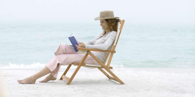 Woman on beach sitting in beach chair